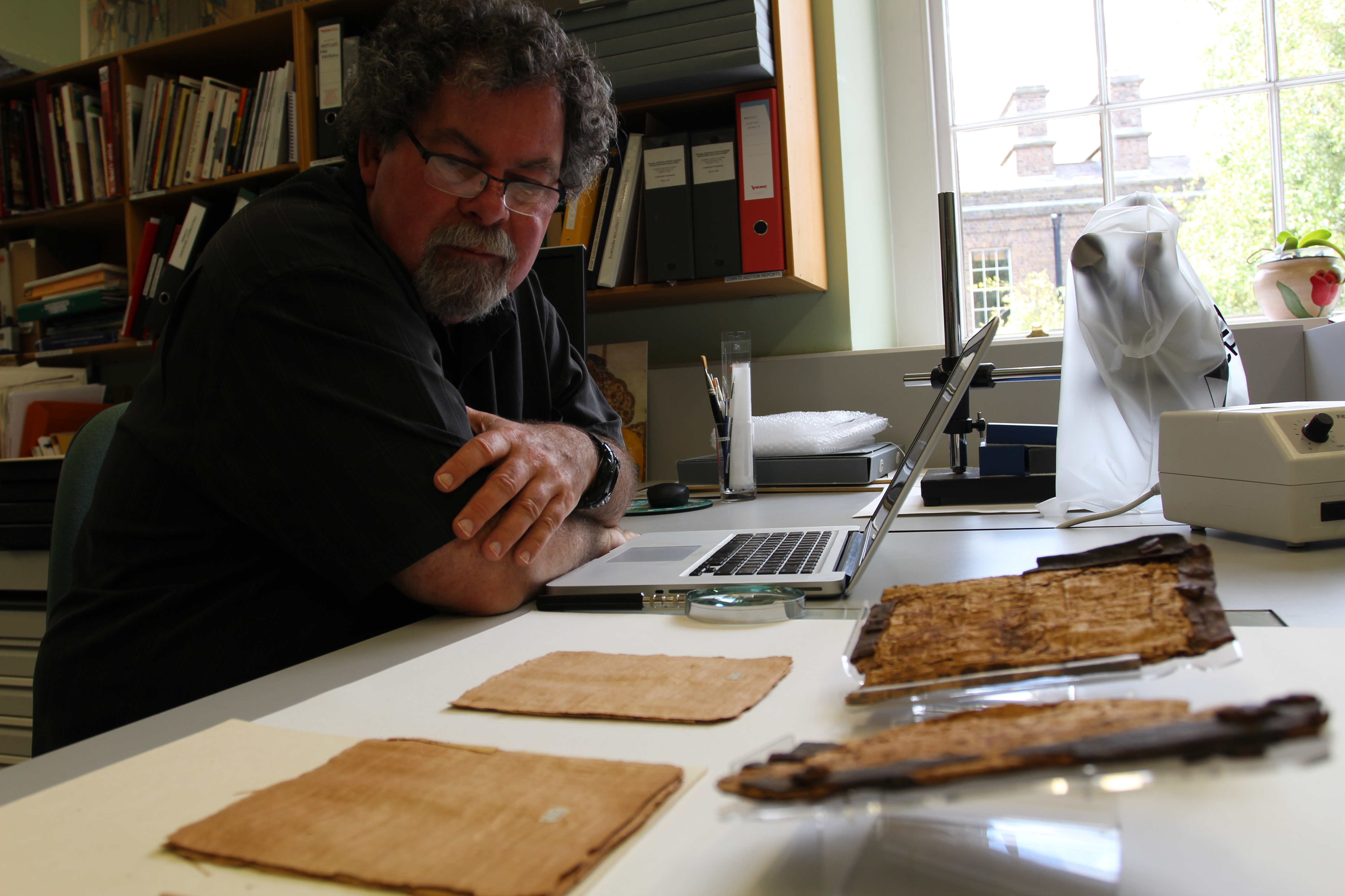 Dan Wallace examines the cover material and blank leaves at the Chester Beatty Library in 2013.