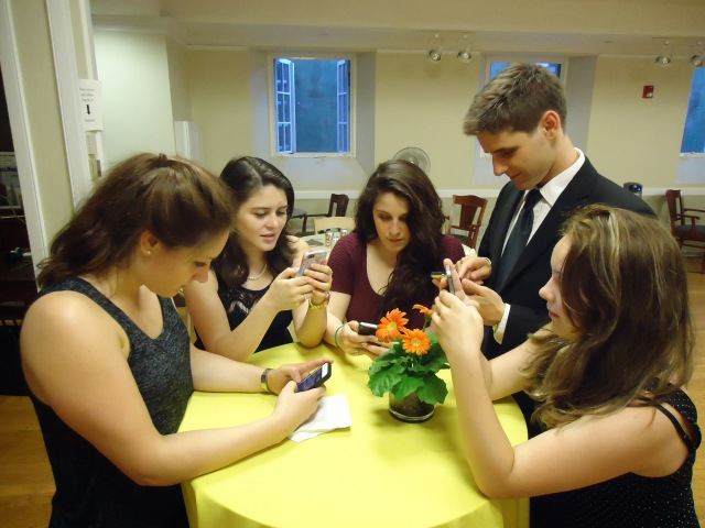 Young_people_texting_on_smartphones_using_thumbs